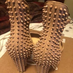 Christian Louboutin Shoes - Christian Louboutins Spiked Nude Strapped Heels